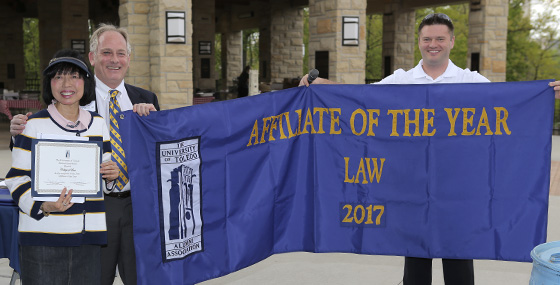 Law Alumni Affiliate representatives holding the Affiliate of the Year banner